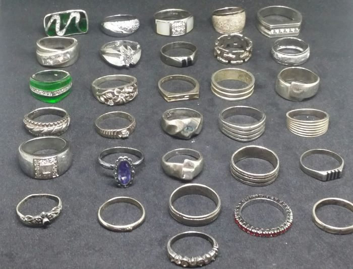 Collection of 38 silver rings