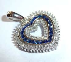 14 kt / 585 white gold pendant in heart shape with 3 layers set with diamonds and sapphires *no reserve price*, 22 x 15.5 mm