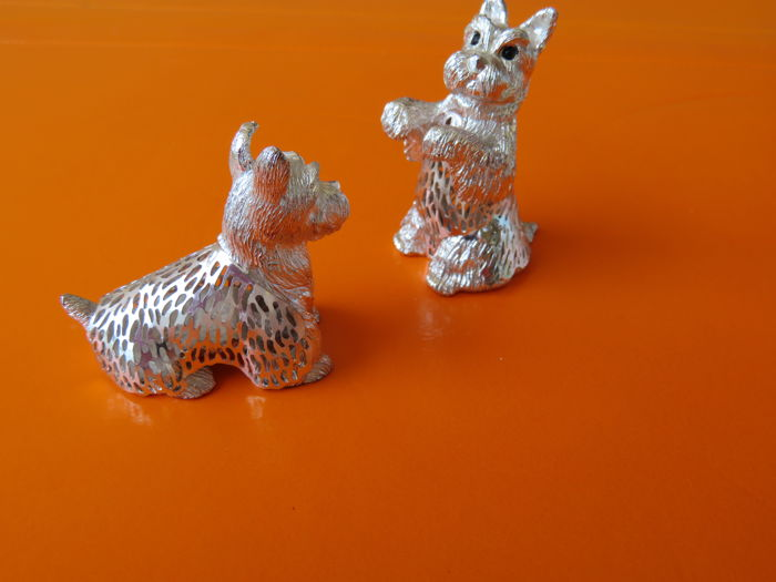 "Christofle - pair of silver dogs from the ""lumière"" series"