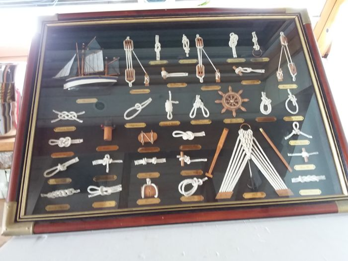 Different sailing knots in a glass display case.