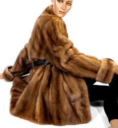 Beautiful feminine mink coat in honey caramel brown, fur coat, mink