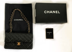 Chanel - Double Flap Bag