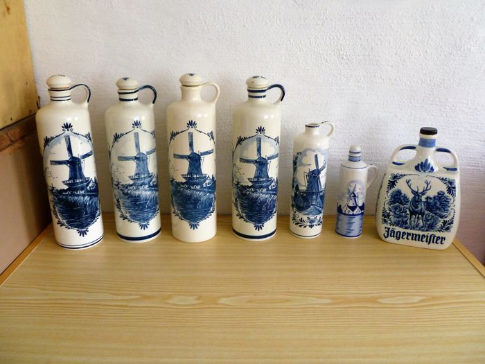 Lot of 7 Gin jugs [beverage jugs]