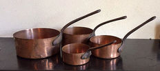 Set copper cookware with cast iron handle, approx. 1950s