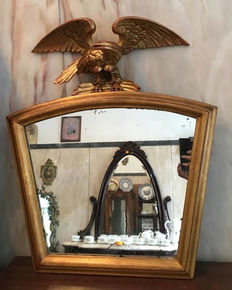 Empire style mirror in gilded wood from the 20th century