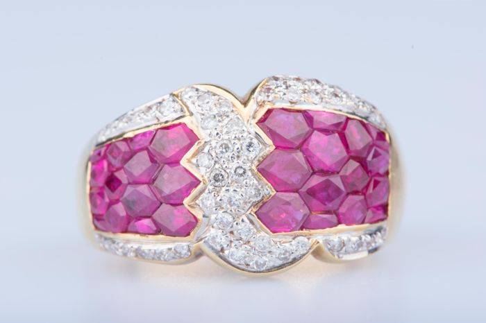 Ring in 18 kt yellow gold with 24 rubies of approx. 0.96 ct in total. 48 diamonds approx. 0.48 ct in total. Size: EU 57, US 8.