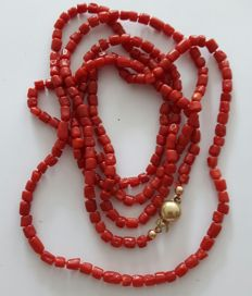 Long precious coral necklace with a gold clasp