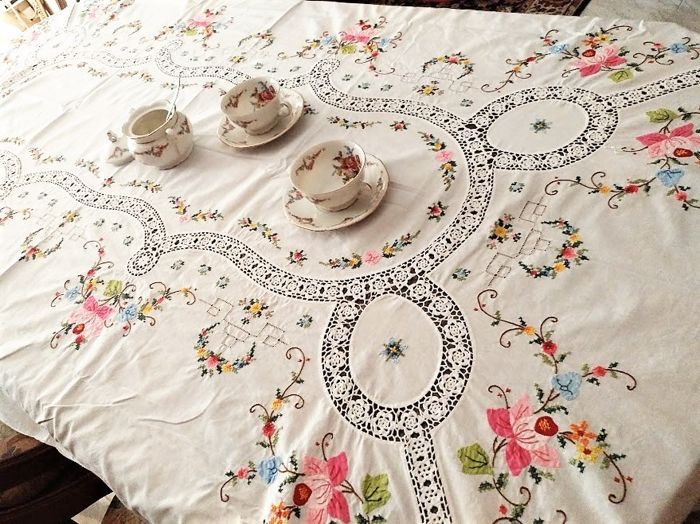 Rectangular tablecloth for 8 people embroidered by hand, cross-stitch with application of fabric, hemstitching and crochet.
