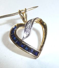 Pendant made of 18 kt / 750 gold with 9 natural carre cut sapphires + 1 diamond, length 23 mm