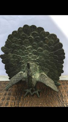 Bronze sculpture of a peacock