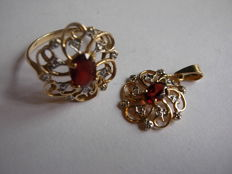 yellow gold 585/1000; A golden ring and a pendant with diamonds and garnets; size 14(54)