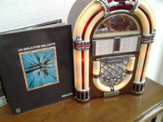 "Vintage juke box - ""The juke box"" midi version - (radio-player + all around electrically illuminated) + book Philips professional Spanish-language edition: ""Un siglo por delante"" !!!"