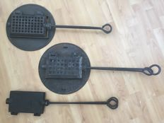3 Cast iron waffle irons of which 2 with holder.
