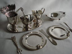 Herbert Hooijkaas: Douwe Egberts: Silver plated tea/coffee set: The milk and sugar set with spoon vase, 11 teaspoons are from Douwe Egberts, Bonbon dish, sugar tongs, sugar spoon, 2 butter knives and two dishes with duck.