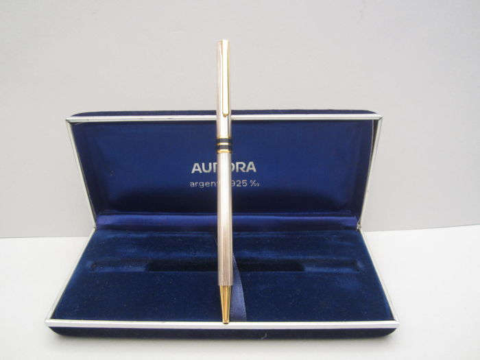 Rare and fine Aurora ballpoint pen in sterling silver with blue enamels. With its original box. In perfect condition