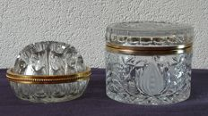 Crystal glass cookie jar and a large crystal flower plug with a gold plated edge