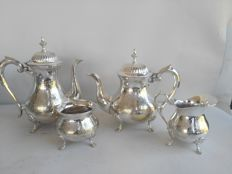 Silver plated 4-piece tea set with stylish design and floral decoration, marked E.P.N.S.