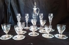 26 piece vintage crystal glasses with hand engraved decanter and coasters.