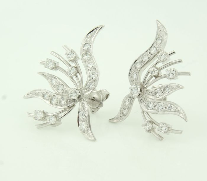 Platinum ear studs with white gold pins set with brilliant cut diamonds