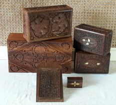 Hand-carved tropical wooden boxes, a memo holder and pill box - partially inlaid with brass