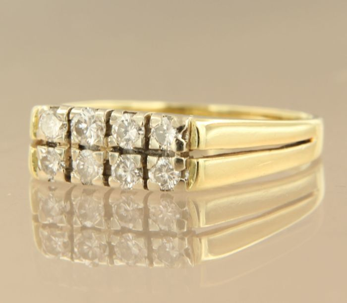 14 kt bi-colour gold ring set with 8 brilliant cut diamonds, approx. 0.32 carat in total, ring size 17.75 (56).