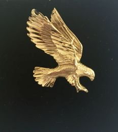 Gold vintage pendant of an eagle about to attack