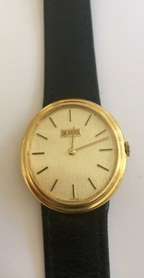Gold Ebel watch with leather strap, hand-wound, ca 1965