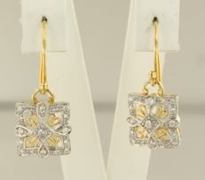 14 kt bi-colour gold dangle earrings  set with 34 brilliant cut diamonds, approx. 0.28 carat in total, size is 2.4 cm long x 1.1 cm wide.