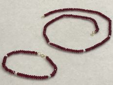 Set of ruby and pearl with 18 kt gold