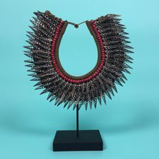 Shell necklace on stand - Papua New Guinea - 21st century.