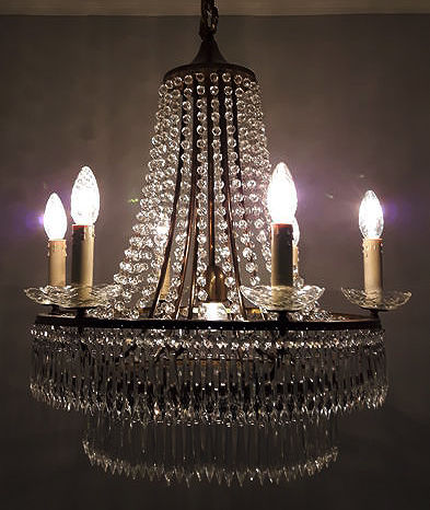 Bronze chandelier set with cut glass crystals