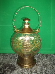 Old richly decorated brass rum bottle with music box - In very good condition