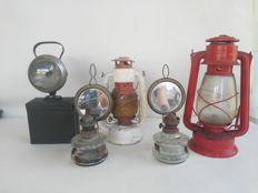 Ancient train station master lamp, plus four oil lamps in iron and glass. From Germany, period: 1900s ca