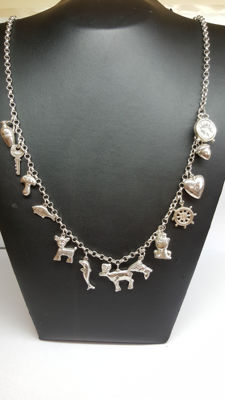 925 Silver women's necklace set with various charms.
