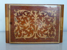 Old jewellery box with two tone wooden mirror with floral and faunal inlays and Swiss MAPSA musical box on four feet.