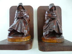2 reading monks as bookends. and a Bible with a wooden cover