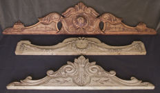 Three ornaments in carved wood, first half of the 20th century, Belgium