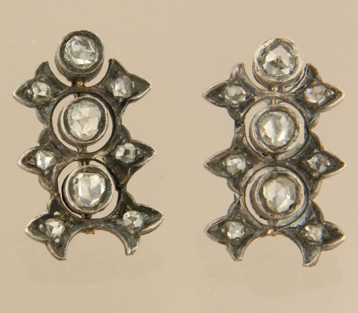 Silver ear studs with gold pins set with rose shape cut diamonds in total approx. 1.00 carat size 2.0 cm x 1.2 cm wide
