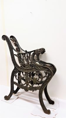 A set of cast-iron garden-bench supports with lion heads - England - ca. 1900