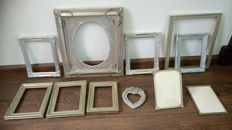 Gorgeous collection of nine gilded frames and two silver-plated picture frames, mid 20th century.