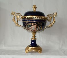 Center table large vase with lid in Limoges style with brass frame.