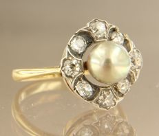 Gold and silver entourage ring with a central cultivated pearl and entourage set Bolshevik cut diamonds