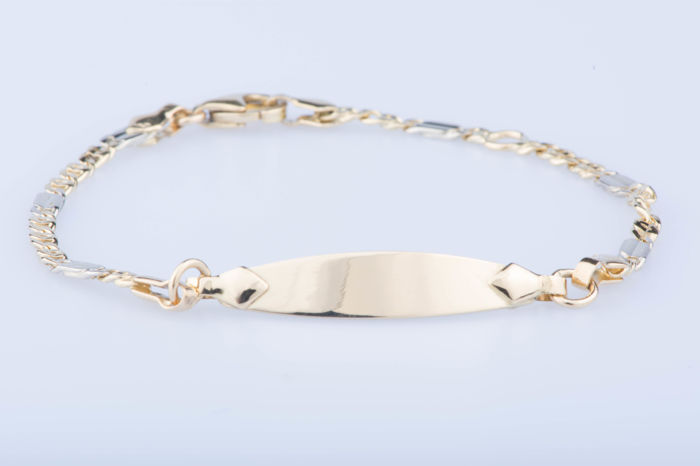 Child's curb chain in 18kt yellow gold; Length: 15.5 cm.