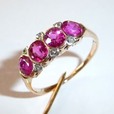 14 kt / 585 gold ring with 4 almost eye-clean natural rubies totalling 2 ct and 6 diamonds