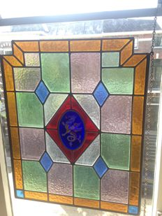 """Gorgeous old and large Jugendstil handmade stained glass window (suncatcher) of oxide gold with soft colours of """"Fire-breathing Dragon""""  - circa 1890"""