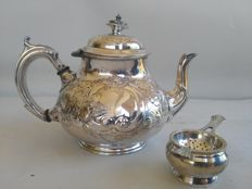 Nice silver plated teapot with floral pattern and infuser for tea