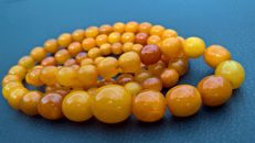 Baltic Amber long necklace from raw Amber with box, in butterscotch,egg yolk colour,  61.7 gr. ca. 1920-1930
