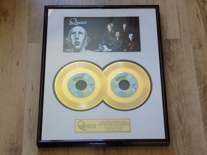 "Queen "" We Will Rock You "" & "" We Are The Champions ""  framed 24kt 7"" gold discs."