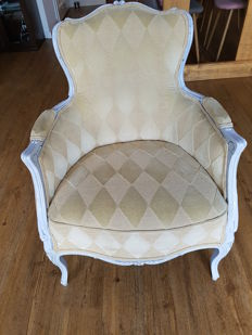 A white painted Louis XV style bèrgere, 20th century
