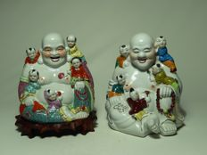Two porcelain statues of Buddha with children – China – second half of the 20th century